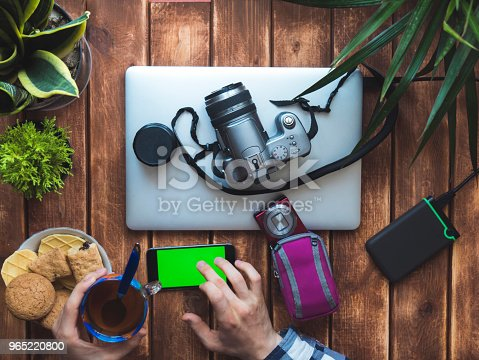Photographer Making A Break With Cup Of Tea And Mobile Phone Stock Photo & More Pictures of Above