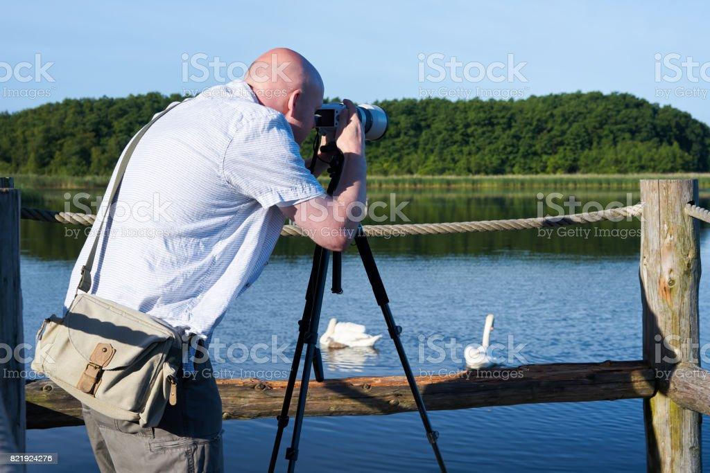 Photographer on a lake stock photo