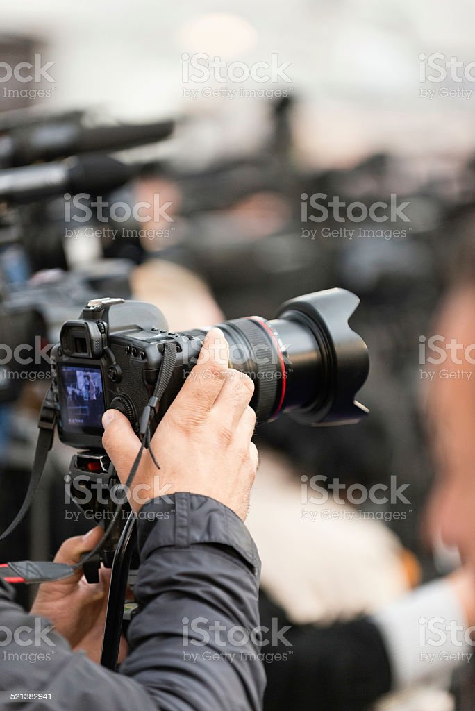 Photographer on a large press conference stock photo