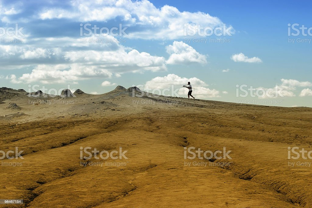 Photographer on arid landscape and blue sky royalty-free stock photo