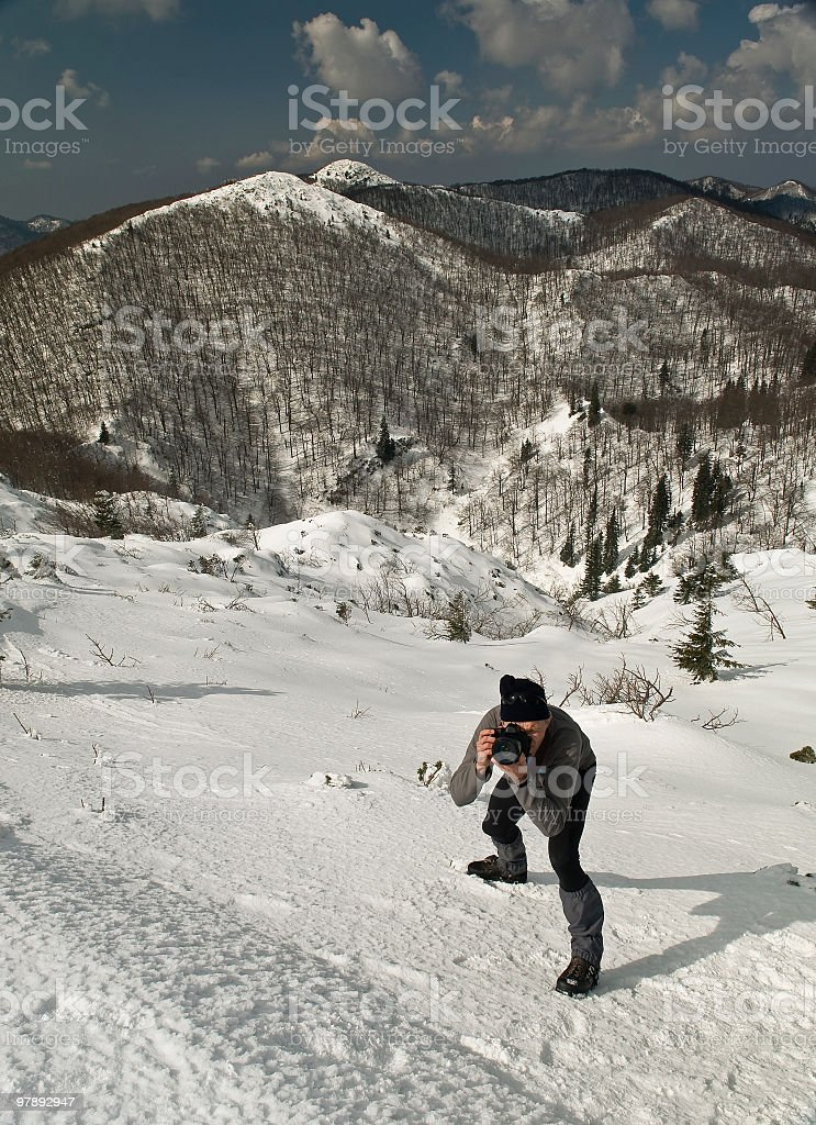 Photographer on Top of Mountain royalty-free stock photo