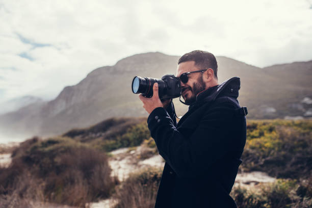 Photographer photographing in nature on winter day stock photo