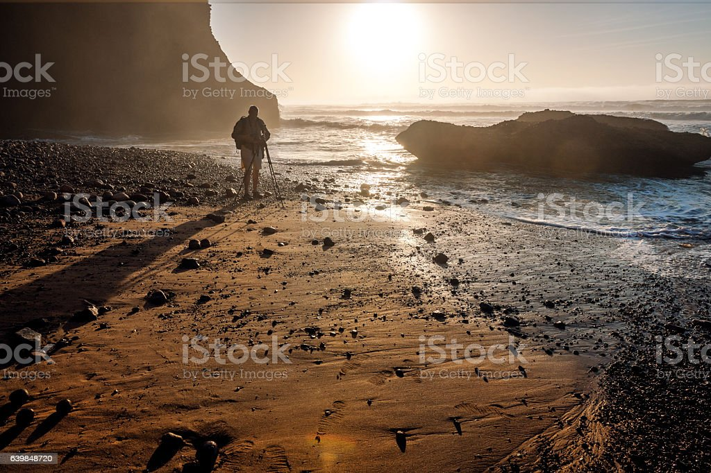 Photographer photographing the coast of the sea in Atlantic Ocean stock photo