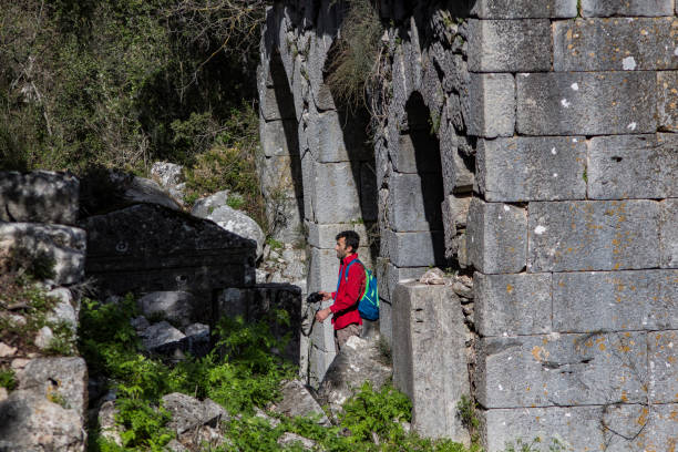 photographer a photographer documenting the history of the ancient city of termessos cerebral aqueduct stock pictures, royalty-free photos & images