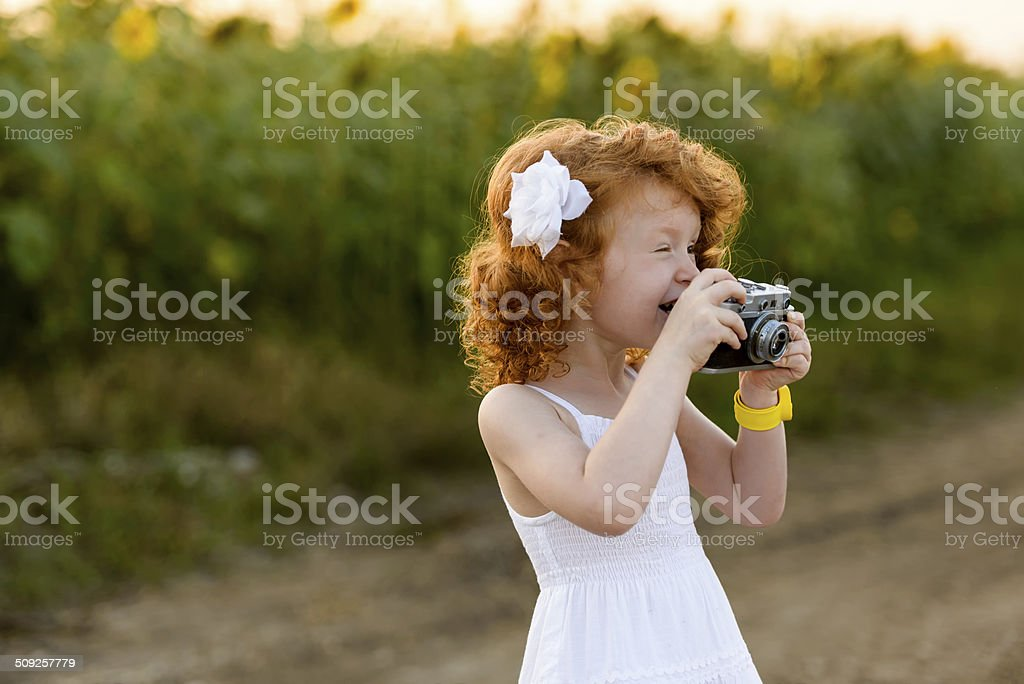 Сheerful photographer stock photo