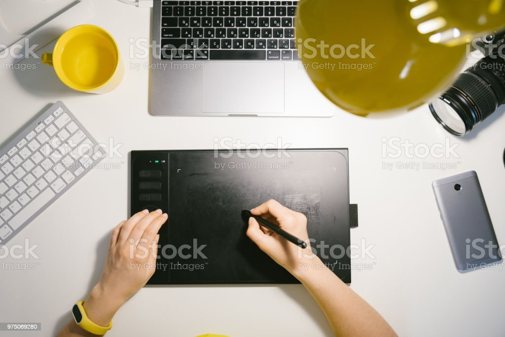 photographer processing photos. workplace. freelancer at work stock photo