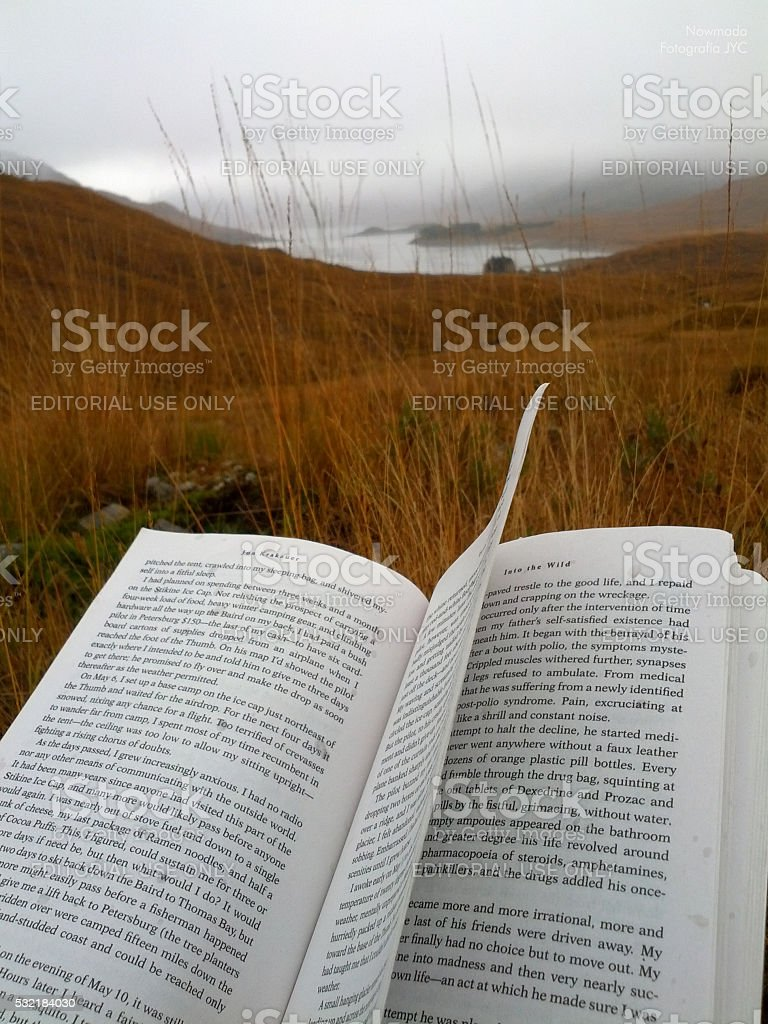 Photographer reading on the hill, Scotland stock photo