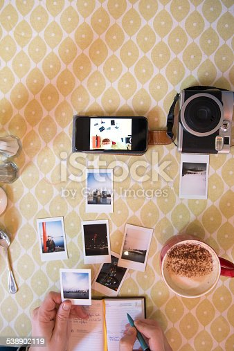 Photographer cataloguing his work in a cafe. ALL PICTURES ARE MY COPYRIGHT.