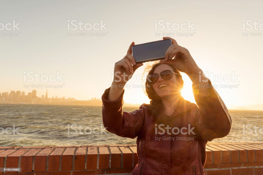 Photographer Shooting Cellphone Selfie stock photo