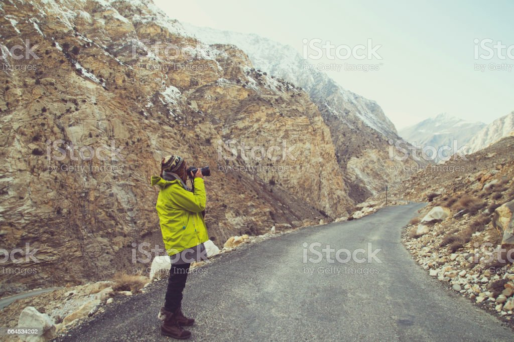 Photographer shooting from Himalayan mountain road royalty-free stock photo