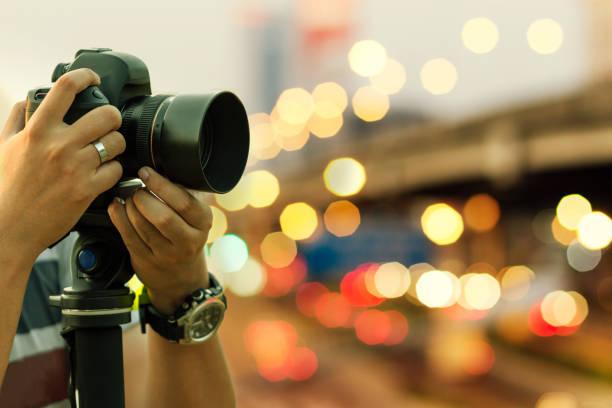 Photographer shooting outdoors on night light retro toned image with picture id1134703513?b=1&k=6&m=1134703513&s=612x612&w=0&h=n6wqo4c4ab3xd rmjfpihkcu oe1qgfyny7slh4sn4k=