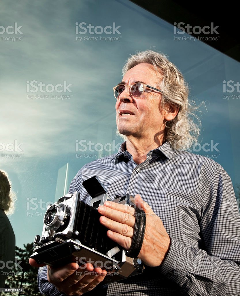 photographer shooting with an old school bellows camera royalty-free stock photo