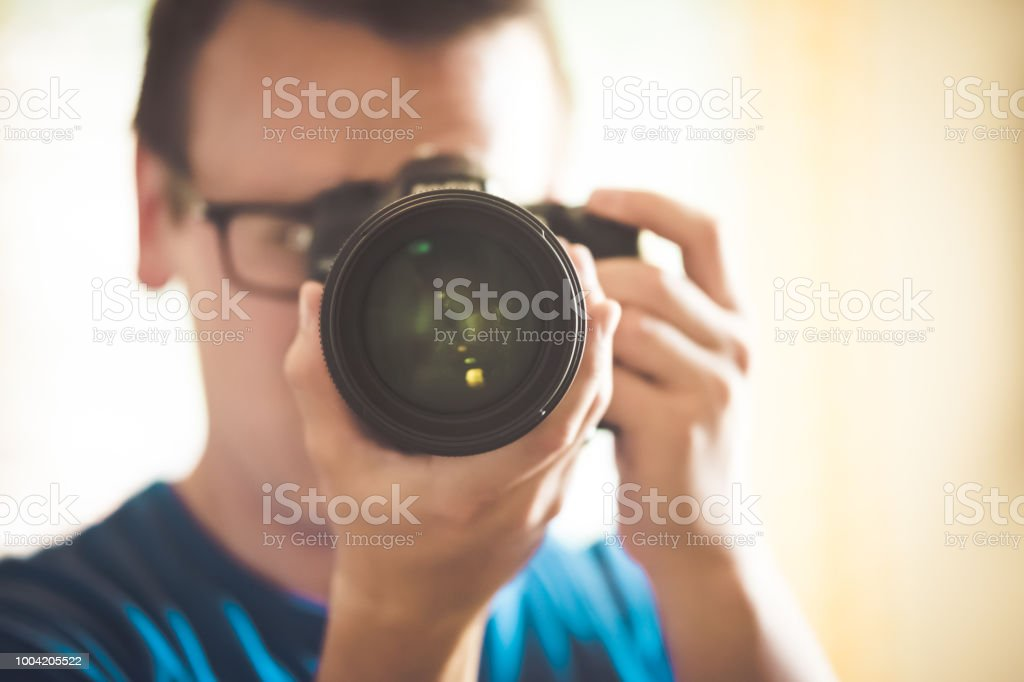 Photographer shoots straight with DSLR stock photo