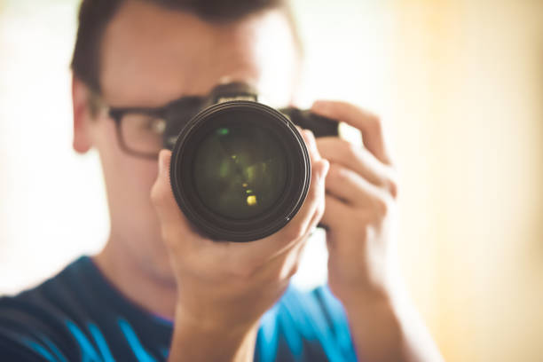photographer shoots straight with dslr - contributor stock pictures, royalty-free photos & images