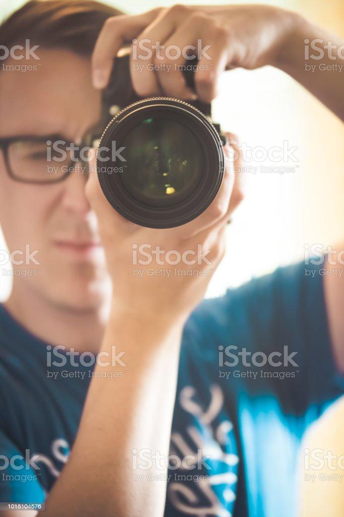 Photographer shoots with DSLR digital camera stock photo