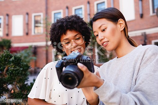 Photographer showing results of shoot to client