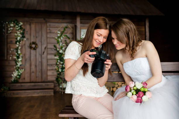 Photographer shows the bride had just taken photos stock photo