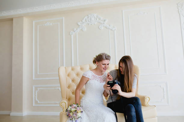 Photographer shows young sexy bride had just taken photos stock photo