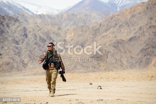 Photographer soldier with camera and telephoto lens.