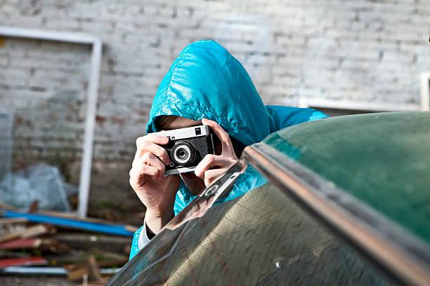 Photographer spying hiding behind a car picture id110901039?b=1&k=6&m=110901039&s=612x612&w=0&h=mxvaa7xlpfiyegrex3egt6cu2h9 axobj3il4ohd  u=