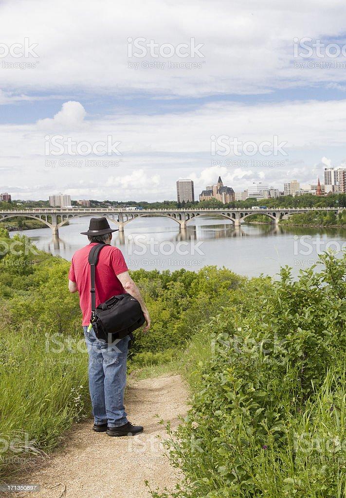 Photographer Standing Near South Saskatchewan River in Saskatoon royalty-free stock photo