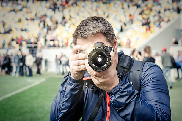 Photographer takes a photo at the stadium picture id610014498?b=1&k=6&m=610014498&s=612x612&w=0&h=tay3cmty0hp39st3anpm nvqjhqx0cyhflp1u2fjh7w=