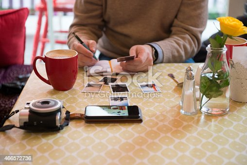 Photographer cataloguing his work in a cafe in Dublin, Ireland. I own the copyright of the images in this picture.