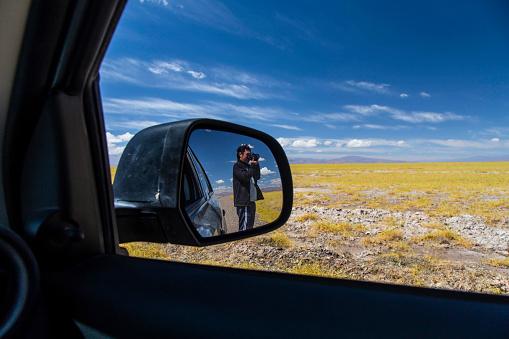 photographer taking a shot thru the mirror