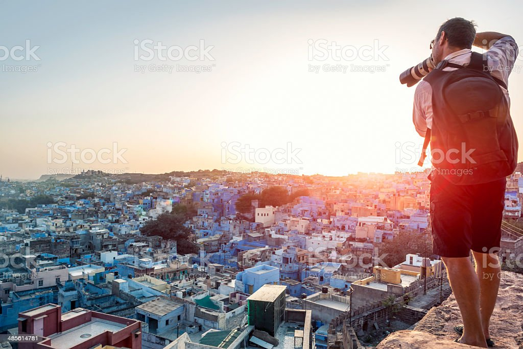 Photographer taking image of the Blue City rooftops, Jodhpur stock photo