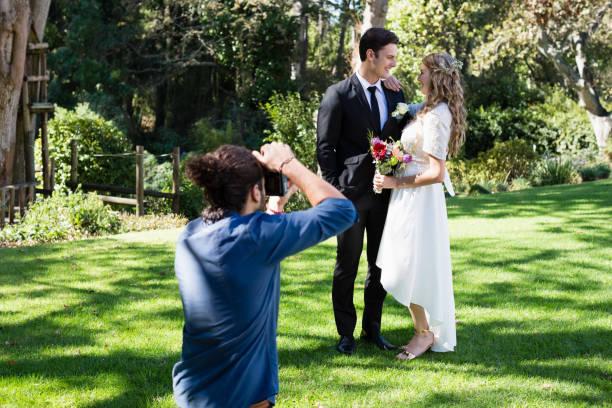 Photographer taking photo of newly married couple picture id829606876?b=1&k=6&m=829606876&s=612x612&w=0&h=5u3febynablp c0pzjmtxymquaod ok5k52e  iwcfy=