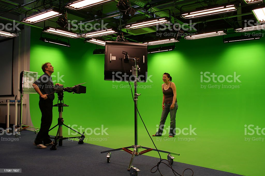 Photographer taking photos in film studio stock photo