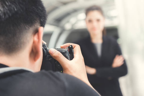 Photographer taking picture of businesswoman picture id1149369378?b=1&k=6&m=1149369378&s=612x612&w=0&h=o3c6x2fgejf73sh4iwycvfvlyxbwoz9ltw7bon41pby=