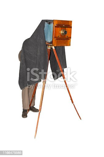 Photographer taking picture with vintage foto camera. Ancient wooden plate camera on tripod. Isolated on white background