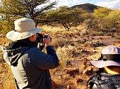 photographer taking pictures in Etosha National Park,Namibia