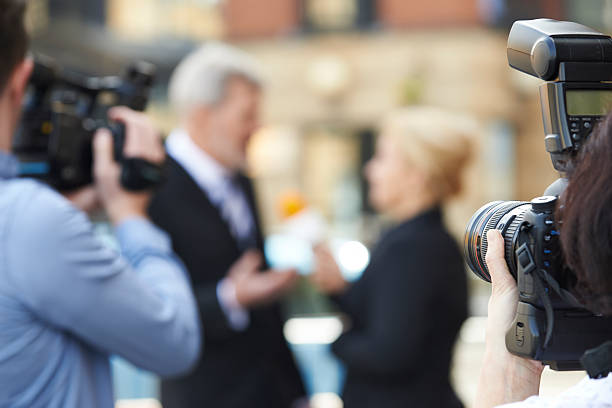 Photographer taking pictures of female journalist interviewing b picture id481704452?b=1&k=6&m=481704452&s=612x612&w=0&h=gpeoksjhcvo8r6s1ub75kv4pfvxschhihxuvri9fqyc=