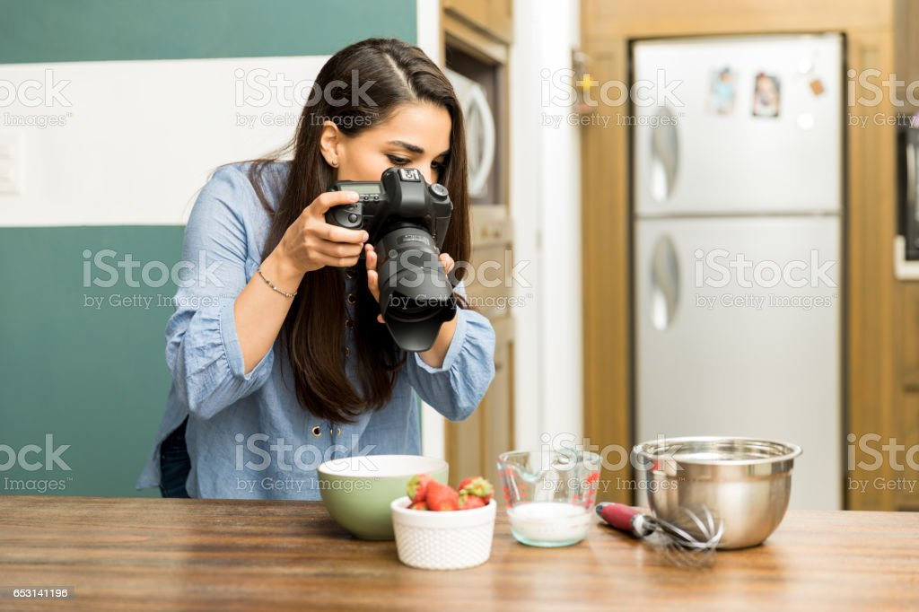 Photographer taking pictures of food stock photo