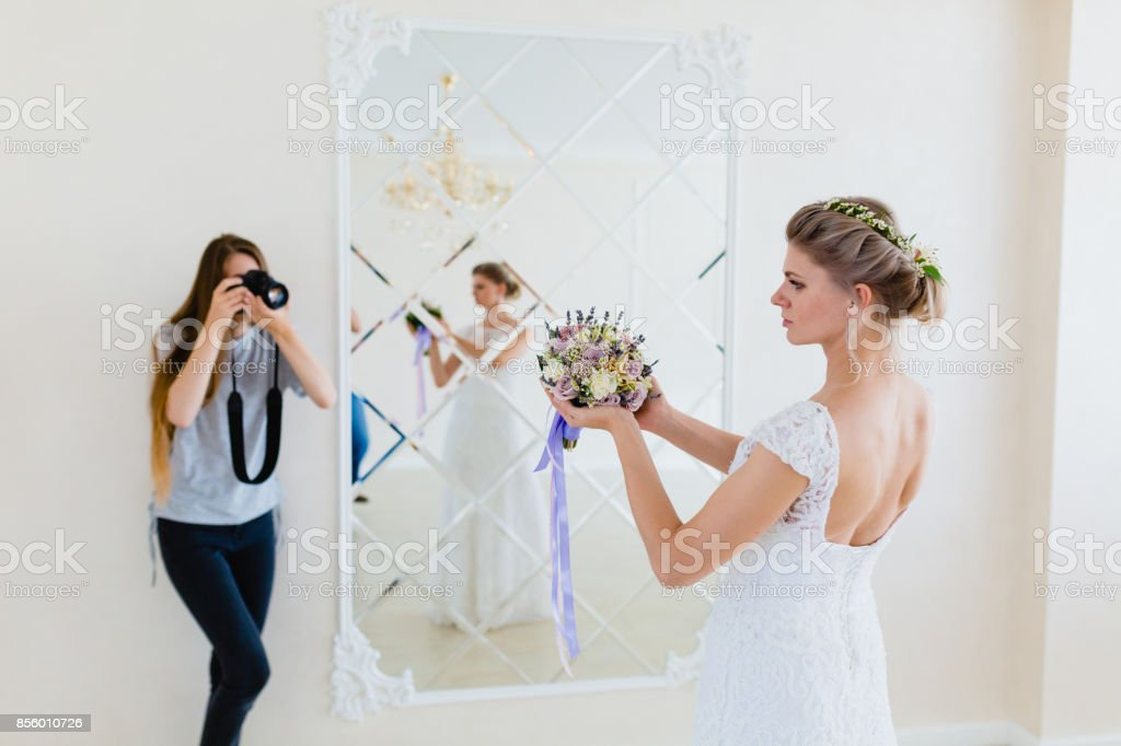 Photographer Taking Pictures The Young Sexy Bride In Studio Near Mirror Royalty Free
