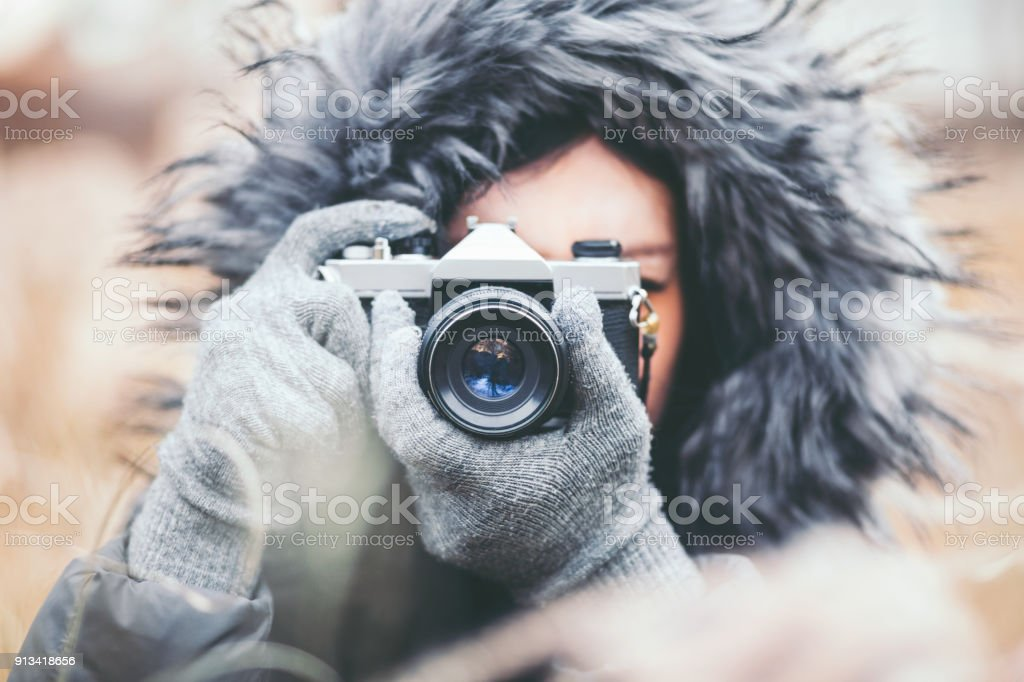 Photographer taking pictures with a retro film camera stock photo
