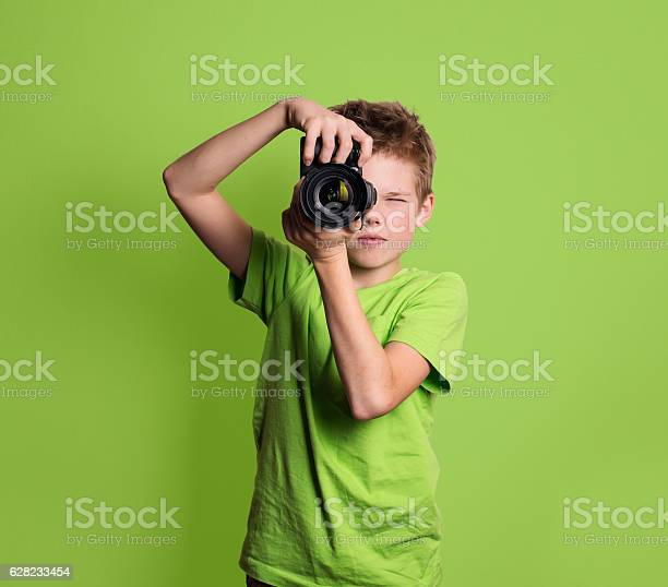 Photographer teenage boy using professional camera isolated on green picture id628233454?b=1&k=6&m=628233454&s=612x612&h=kjrcssv8iwxqi5kri ibff8adt ncapgcy2m0wwq18m=