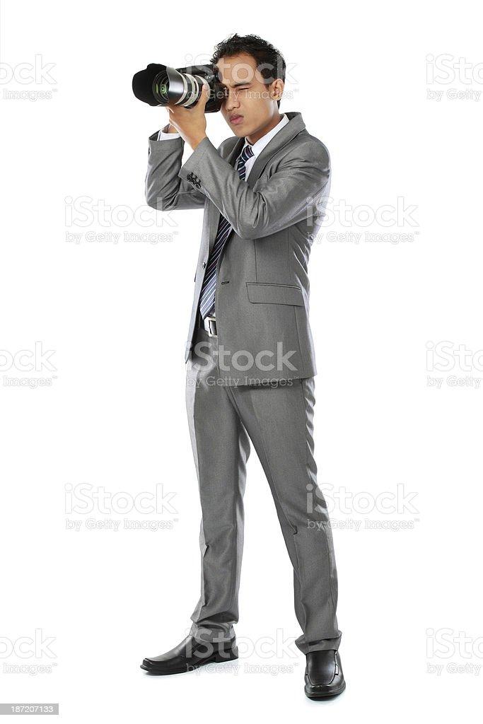 photographer using dslr camera royalty-free stock photo