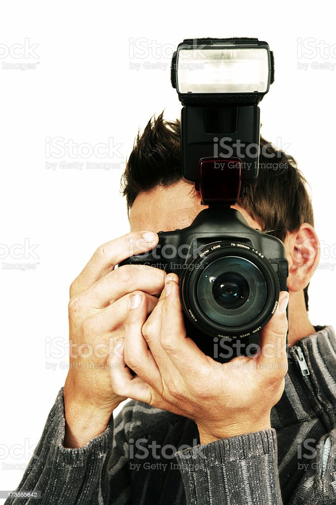 Photographer using DSLR camera with flash royalty-free stock photo