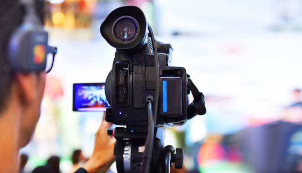 Photographer video recording activity Photographer video recording activity, television cameras in a row broadcasting a live media event. ultra high definition television stock pictures, royalty-free photos & images