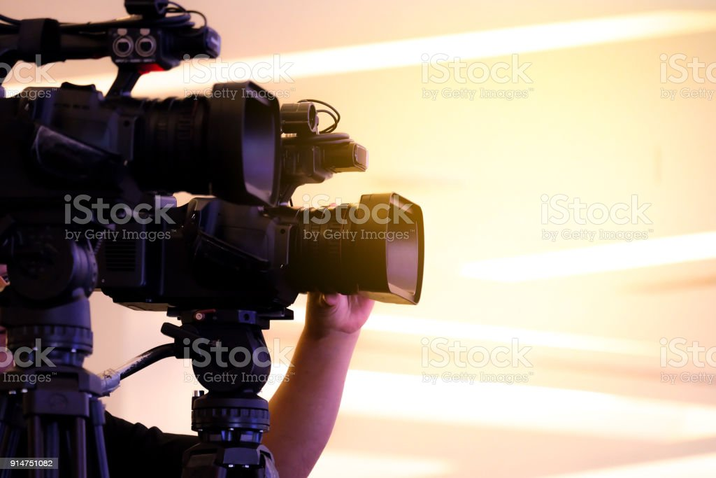 Photographer video recording activity within the event stock photo