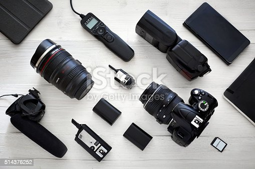photography & videography equipment from top view. white wooden table with deep depth of field.
