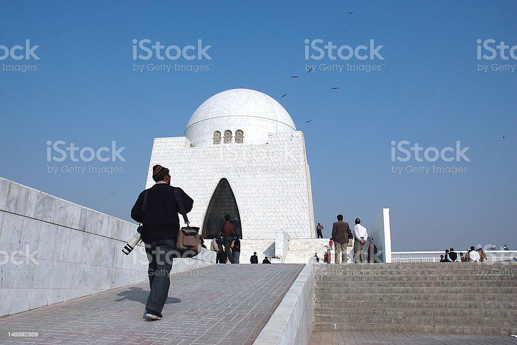 Photographer walks up Quaid's Tomb stock photo