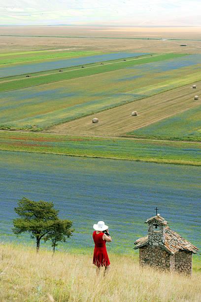 Photographer wearing red dress abd white hat near castelluccio italy picture id487259856?b=1&k=6&m=487259856&s=612x612&w=0&h=e5yhwwpdetzoholqloxuzceg1188rfkrwqhnvniuons=