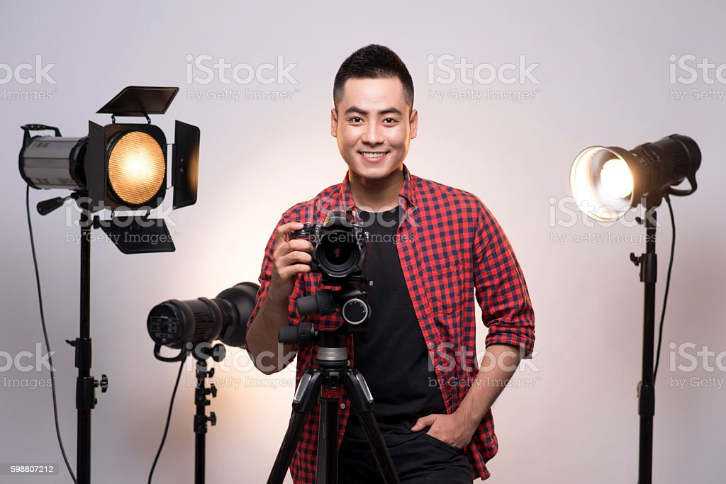 Photographer with camera and tripod stock photo