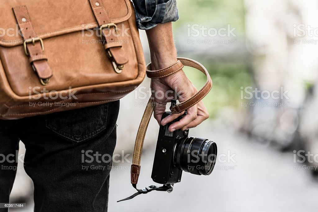 Photographer with leather bag in the city stock photo