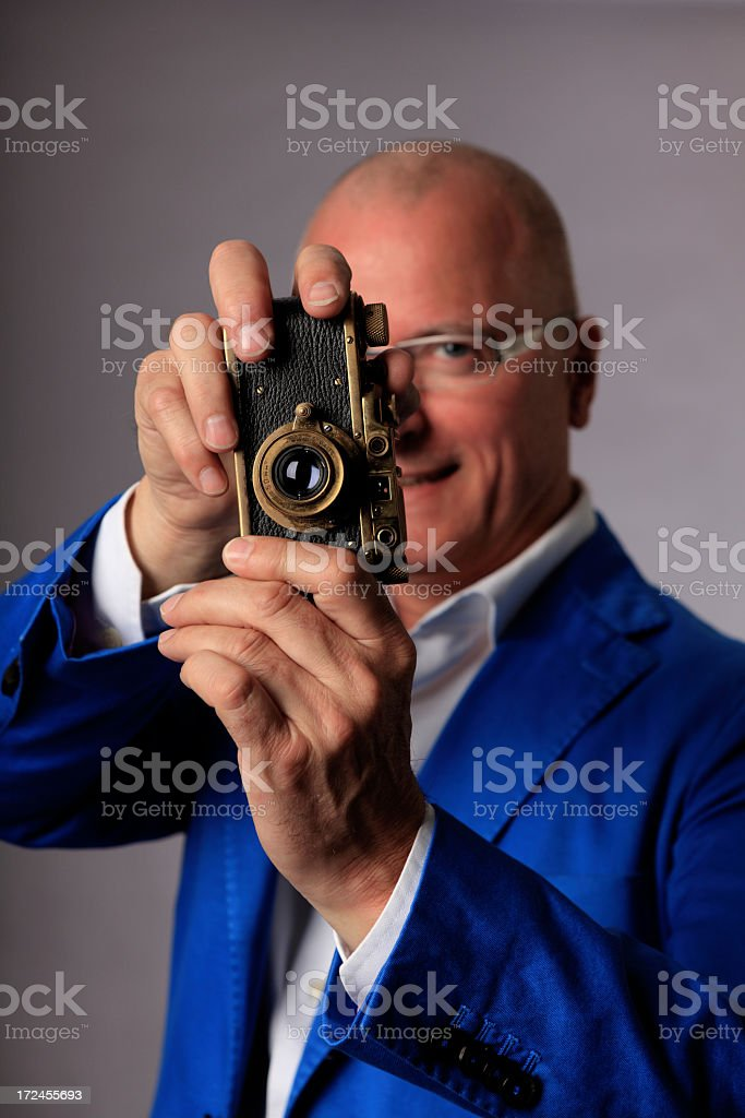 Photographer with old camera stock photo