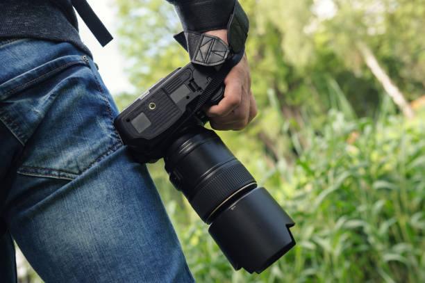 Ein Fotograf mit der Kamera. – Foto